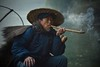 Fisherman's Blues (Anna Kwa) Tags: cormorantfisherman smoking pipe portrait moment liriver morning yangshuo guilin guangxi southwest china annakwa nikon d750 afsnikkor70200mmf28gedvrii my blues always far away bitter memories seeing heart soul throughmylens travel world 等 waiting 模糊 vague 回来 return 疲倦 tired