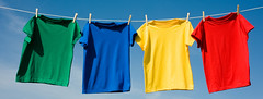 primarios 1a (FotoGráfico Taller) Tags: tshirts shirts cotton clothesline clothes clothing object clothespins pins rope objects textiles red yellow green blue sky background copyspace addtext graphic hanging colors bright colorful pretty casual fashion unitedstatesofamerica