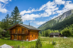 The beauty of the Swiss Alps (Tobias MxR Photography) Tags: swiss alps summer mountain house grass vegetation sky light blue green orange brown cloud clouds tree trees forest hiking mont blank tour du wood tiles beautiful colour color