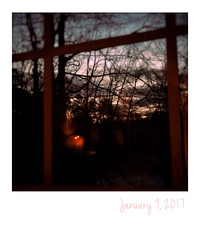 Cozy Sunrise (jeanne.marie.) Tags: snowday instant iphone7plus iphoneography silhouettes trees cold winter cozy flame candle window sunrise 365the2017edition 3652017 day9365 9jan17