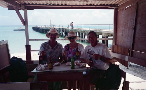 Willie, Kaye and Bill share a meal in Hillsborough, Carriacou.