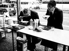 Eating on your feet  - Tokyo (-Faisal Aljunied-) Tags: nochairs eatingonyourfeet streetphotography japan tokyo ricohgr faisalaljunied