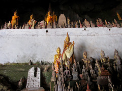 Pak Ou Caves Laos (shaire productions) Tags: travel sculpture cliff mountains tourism water beauty river religious photo artwork asia southeastasia natural image buddha buddhist religion picture statues buddhism hills caves photograph sacred limestone traveling figurine laos figures mekongriver namou pakou pakbeng tamtingcave