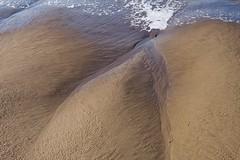 Cleft (ADMurr) Tags: california beach closeup triangle cleft leica m 50mm zeiss planar sand silica water