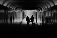 The light at the end / La luz al final... (Luis DLF) Tags: light black white girls sub tunel london uk england shadows bw suitcase maleta londres clarooscuro siluetas