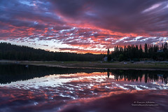 Reflections on Bass Lake (Darvin Atkeson) Tags: california sunset lake mountains reflection fog forest mirror town glow nevada small shoreline sierra resort pines shore forks basslake illuminate 2015 darvin darv lynneal yosemitelandscapescom