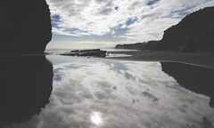 underwater (Paul J's) Tags: sea cloud reflection beach rock clouds sisters river three formation threesisters tasman formations taranaki 3sisters tongaporutu