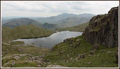 Stickle-tarn. (stu.bloggs..Dont do Sundays) Tags: summer cliff mountains water june landscape scenery rocks cloudy path lakedistrict scenic cumbria fells views paths tarn mountainlake lakeland stickletarn paveyark rockyoutcrops