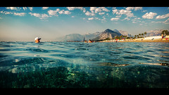 A morning of thoughts and plans (Melissa Maples) Tags: cameraphone trees sea summer panorama cinema mountains beach apple water clouds turkey asia mediterranean widescreen trkiye panoramic palmtrees antalya letterbox cinematic iphone liman  iphone6 konyaaltbeach