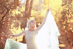 Sun Goddess (Kelly McCarthy Photography) Tags: woman model beautiful beauty fashion style blonde light naturallight yellow catchycolorsyellow bodysuit gold golden outdoors forest woods makeup enchanting wings pose tattoo fairytale fall autumn leaves bokeh bokehwhores