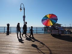 Light and Shade (Feldore) Tags: santa monica boardwalk sun umbrella colours california silhouettes feldore mchugh em1 olympus 1240mm