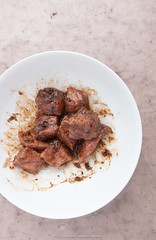 In ras el hanout marinated chopped veal. (annick vanderschelden) Tags: acidic bowl brownish chopped food liquid marination oliveoil pointofview process seasoned soaking spices vel