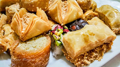 Baklava - different varieties in closeup (Victor Wong (sfe-co2)) Tags: arabian arabic asia background baked bakery baklava baklawa breakfast cafe cake central closeup confectionery cuisine culture delicious delight dessert dough east eastern food gourmet green hazelnut honey ingredient isolated lunch macro mediterranean middle nut oriental pastry pistachio plate ramadan snack sticky sugar sweet syrup taste tasty tea traditional turkey turkish walnut west white wooden