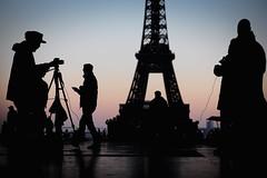 Another Evening In Paris (Gwenaël Piaser) Tags: paris parigi france francia îledefrance 85mm 85mmf18 canonef85mmf18usm ef85mmf18usm ef85mm usm ef85mmusm canonef85mm118usm prime unlimitedphotos gwenaelpiaser canon eos 6d canoneos eos6d canoneos6d fullframe 24x36 reflex rawtherapee eiffeltower eiffel tower tour sunset backlight contrejour trocadero parvisdesdroitsdelhomme parvis silhouette photographer casquette cap hat walking 2500