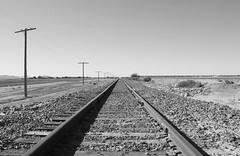 West Line (BCooner) Tags: arizona goodyearaz horizon railroadtracks powerlines perspective vanishingpoint