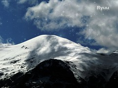 shadow play on snowy mountain (Ola 竜) Tags: snow mountain blue sky white cloud gray clouds shadows light snowy mountains insnow snowing snowflakes rocks peak peaks shadowplay nature high zoom skyscape landscape horizon cold winter wintermagic