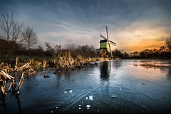 winter in Holland (bjdewagenaar) Tags: windmill ice dutch holland gorinchem wide angle sigma 1020mm winter blue orange landscape waterscape trees nature sony a58 alpha raw lightroom photoshop