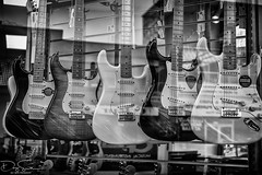 guitars on show (Daz Smith) Tags: dazsmith fujixt10 fuji xt10 andwhite bath city streetphotography people candid canon portrait citylife thecity urban streets uk monochrome blancoynegro blackandwhite mono shop window reflection guitars musical instruments