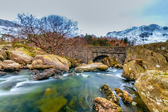 Into the valley (Lee~Harris) Tags: water longexposure tree mountains landscape landscapes serene wales ogwenvalley snowdonia snowcappedmountain colour colours love rugged bridge nature scenery uk nikon nikond300 outdoor waterfall nationalpark