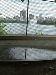 2003-8-5 008 (thrushlistener) Tags: nyc newyorkcity reflection fountain buildings reflections puddle reservoir chainlinkfence puddles oldfence centralparkreservoir 150thanniversary jacquelinekennedyonassisreservoir centraopark centralpark150thanniversary