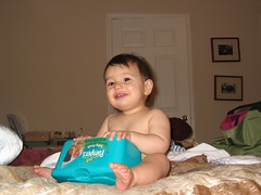 Naked Mason loves the diaper wipe box - by .imelda