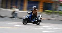 Bike problem. (Alex Vinter (aka Wam Mosely)) Tags: china man motion blur bike tag3 taggedout tag2 tag1 helmet problem shutter lookatme fuzhou