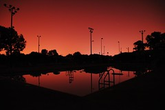 A pool in Lakewood is lit by the glow of Cleveland during a localized blackout (spatulated) Tags: top10 top30