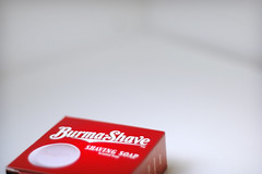 Burma Shave (ilmungo) Tags: red white classic topv111 vintage lyrics soap dof song background burma style whitebackground negativespace shaving shave product whiteground selectivefocus 50mmf18 burmashave shavingsoap mrtomwaits