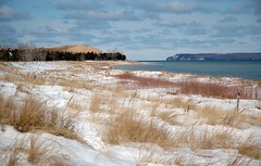 Sleeping Bear Bay (joeldinda) Tags: blue snow beach island bay sand raw d70 dune lakemichigan greatlakes michiganfavorites michiganparks grasses manitou 125fav sleepingbear joeldinda photocontesttnc08 nationalparkstnc08