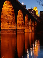 Minneapolis from the Stone Arch Bridge (rrazor) Tags: city bridge reflection water minnesota fantastic arch nightshot dusk mississippiriver stonearchbridge riverlights tcfg306 minneapoliis