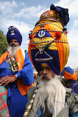 Old Nihang (Captain Suresh Sharma) Tags: travel blue portrait people india yellow festival race soldier dress unique traditional religion oldman fair warrior procession turban sikh punjab spiritual holi weapons bold