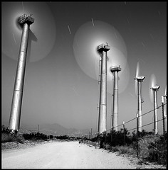 Wind Power (etravus) Tags: california road ca longexposure nightphotography travel vacation sky bw mountains green 120 tourism nature metal fence mediumformat blackwhite interestingness amazing interesting energy whitewater exposure flickr tour power forsale searchthebest natural wind circles extreme palmsprings towers away windmills save adventure dirt winner electricity travis dirtroad vanishing barbwire top20night turbine resource windfarm renewable startrails windpower banning lod timedexposure 500x500 hasselbad calendarshot outstandingshots travisprice longexsposures hasselbladsuperwide etravus winnerflickrsweekly50contest abigfave megashot gerator winner500