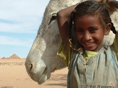 -Girl from Jebel Barkal- (Vt Hassan) Tags: africa portrait people girl smile face topv111 top20childportrait pyramid sudan donkey pyramids juxtaposition soe archeological top20childportraithof abigfave spiritofphotography mondocafeclub