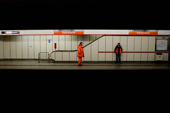 we watch life pass us by (sam b-r) Tags: vienna wien orange topf25 station underground subway austria waiting metro viena gasometer s61200536 noaddedborders nikonstunninggallery top20vienna sambrimages