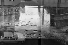 town/puddles (knautia) Tags: uk england blackandwhite bw film wet 35mm bristol march scotland town snowy doubleexposure glasgow 2006 lunchhour lunchtime ishootfilm publicart puddles collaboration watergate templequay x2 taleoftwocities totc totc11 zenitroll15 alephknaut ilfordxpsuper