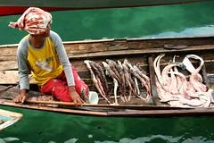 saitan (Farl) Tags: travel sea food woman fish water colors lady shark boat market muslim philippines floating mercado seafood vendor sulu tradition economy floatingmarket mindanao temper tawitawi sitangkai bajao sibutu purung saitan fivestarsgallery fsgmen