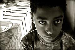 What to do… (carf) Tags: poverty brazil bw boys brasil kids children hope blackwhite kid eyes community education support child hummingbird forsakenpeople esperança social impoverished underprivileged altruism educational beijaflor development investment prevention matheus itanhaem recuperation photophilosophy mundouno blackribbonicon