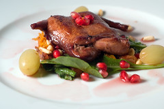 Roasted Quail with a Warm Arugula Salad and Grape Reduction Sauce (ilmungo) Tags: frenchlaundryday2 dinner party food presentation roastedquail warmarugulasalad grapereductionsauce quail pomegranate seeds grape arugula topv111