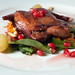 Roasted Quail with a Warm Arugula Salad and Grape Reduction Sauce