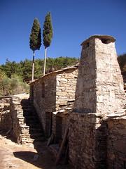 Ikaria 005 (isl_gr (Mnesterophonia)) Tags: chimney house architecture beautyconcealed ikaria  aegean replacement greece tradition cypresses theisland  cypres hikingtrails hikingikaria  canyonwind geniiloci top20greece