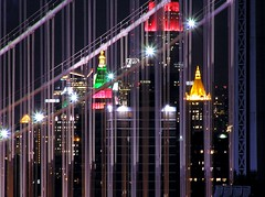 Harp (Linus Gelber) Tags: nyc longexposure bridge newyork topf25 topv111 skyline night lights nightscape picturesthroughholes topv1111 topv999 dumbo cables manhattanbridge empirestatebuilding woolworthbuilding utatadrawslines utatafeature