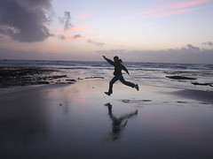 Jeremy jumping between the tidepools (Sourire) Tags: ocean california new boy sunset vacation man west reflection beach silhouette happy freedom jumping alone dancing sandiego air year free content dancer jeremy moment bliss carlsbad seashore tidepools great1 leaping