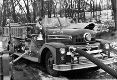 Engine 4, playing in the snow (joeldinda) Tags: bw truck fire blackwhite notbyme kalamazoo martinsernstinger kfd joeldinda kalamazoofiredepartment