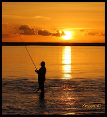 The  smoker fisherman (Zeygom) Tags: fisherman fish beach sea sunset sunsets sun silhouette cigar cigarrete