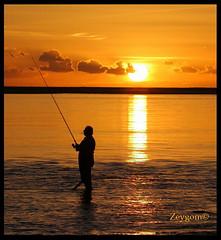 The  smoker fisherman (Zeygom) Tags: fisherman fish beach sea sunset sunsets sun silhouette cigar cigarrete