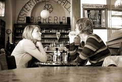 dreamy couple (loungerie) Tags: internationalexpositionpeople boy bw milan boyfriend girl fashion sepia bar 1025fav wonder blackwhite interestingness topv333 waiting couple sitting milano moda fair bn loveit nostalgia alist blond thinking happycouple dreamy inlove biancoenero osteria coppia pallone fiance innamorati girlfrien topphotoblog interestingness53 byloungerie osteriadelpallone ie2007boundaries ie2007boundaries2 ie2007boundariesloungerie brp079