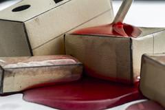 Who Killed Danbo? (theaftergloweffect) Tags: macro up closeup paper blood origami close cardboard murder carton sang papier danbo scène mise pliage meurtre