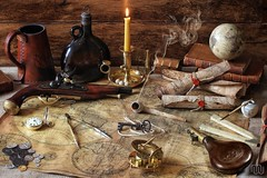 The Pirate Captain's Cabin (memoryweaver) Tags: stilllife pirates maps parchment pirate cartography antiques nautical navigation buccaneer flintlock treasuremap denix leatherboundbooks piratetreasure claypipe oldmaps doubloons powderflask quillpen leatherbooks denixreplica memoryweaver
