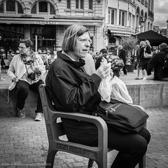 Enjoying Lunch (gwpics) Tags: people blackandwhite bw food monochrome person mono sitting belgium eating streetphotography lifestyle belgian antwerp society antwerpen socialdocumentary flanders socialcomment streetpics strasenfotograpfie