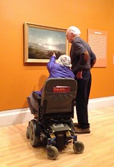 Question of Geography (Melinda Stuart) Tags: artofthewest ferdinandrichardt richardt museum sanfrancisco goldengate sunset visitors wheelchair pointing man woman geography finearts couple seniors gallery framed painting oiloncanvas disability accessibility activity culture artappreciation famsf legionofhonor yerbabuena history